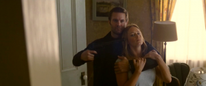 Garret Dillahunt and Emily Blunt in Looper